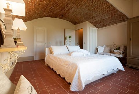 a-quiet-room-with-an-antique-ceiling-in-bricks